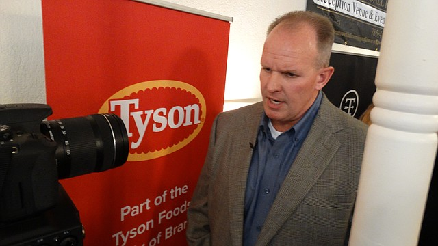 Doug Ramsey, group president of poultry for Tyson Foods, Inc., answers media questions as the company announces plans to build a $320 million poultry processing plant near Tonganoxie. The project is still subject to regulatory and financing approval.