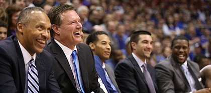 Kansas head coach Bill Self and his staff have a laugh during the Senior Night speeches following the JayhawksÕ 73-63, comeback win over Oklahoma.