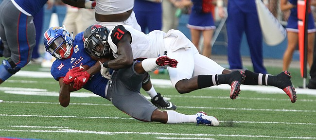 Kansas wide receiver Quan Hampton (6) is hit by Southeast Missouri safety Omar Pierre-Louis (21) after a catch during the second quarter on Saturday, Sept. 2, 2017 at Memorial Stadium.