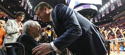 Kansas head coach Bill Self gives his well wishes to legendary Oklahoma State head coach Eddie Sutton following the Jayhawks' 90-85 win over the Cowboys, Saturday, March 4, 2017 at Gallagher-Iba Arena.