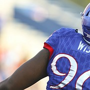 Kansas defensive tackle Daniel Wise (96) and Kansas defensive tackle Isi Holani celebrate a defensive stop during the first quarter on Saturday, Sept. 2, 2017 at Memorial Stadium.