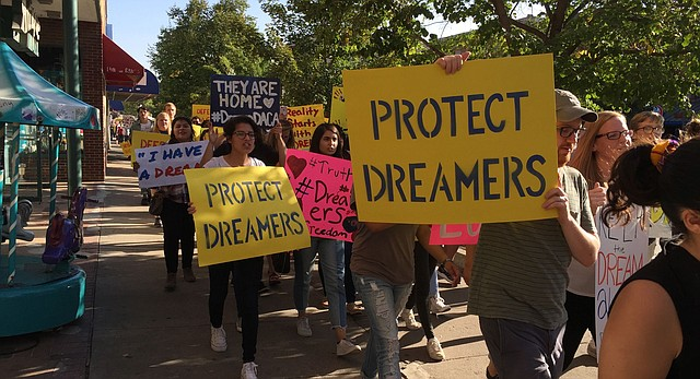 About 150 people participated Thursday, Sept. 7, 2017, in a march downtown in support of the Deferred Action for Childhood Arrivals program.
