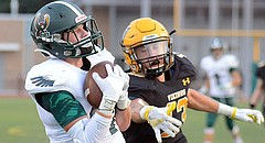 Jake Rittman catches the ball on his way to score for Free State against Shawnee Mission West during the first quarter on Friday, Sept. 1, 2017 at Shawnee Mission South District Stadium.