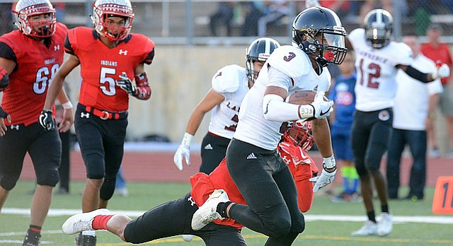 Jalen Dudley makes his way to the end zone as Lawrence High scored early on Shawnee Mission North during the first quarter on Thursday, Sept. 7, 2017 at Shawnee Mission North District Stadium.