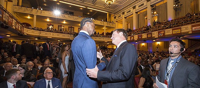 University of Kansas head basketball coach Bill Self is greeted by former player and current Minnesota Timberwolves player Andrew Wiggins during the Naismith Memorial Basketball Hall of Fame induction ceremony on Friday, Sept. 8 2017 at Symphony Hall in Springfield, Massachusetts.