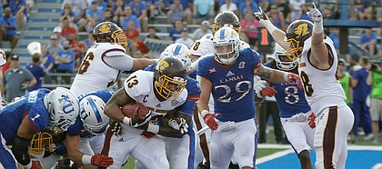 Central Michigan running back Devon Spalding (13) runs past KU defenders for a touchdown in the second-half of CMU's win over KU Saturday, Sept. 9 at Memorial Stadium.