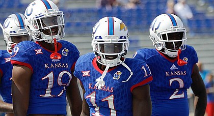Kansas junior receiver Steven Sims Jr., center, cracks a smile in pre-game warmups prior to Saturday's game against Central Michigan at Memorial Stadium.