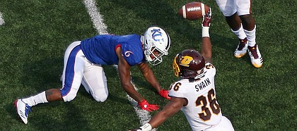 Central Michigan defensive back Tyjuan Swain rips the ball away from Kansas receiver Quan Hampton for an interception on Saturday at Memorial Stadium.