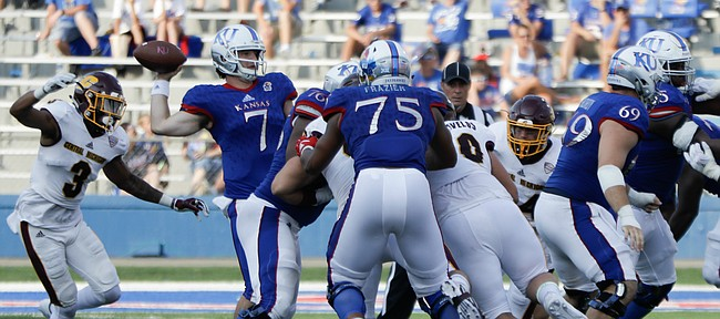 Kansas quarterback Peyton Bender (7) passes while under pressure from the CMU defense during the Jayhawks game against Central Michigan Saturday, Sept. 9 at Memorial Stadium.