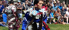 Haskell Indian University junior Shay Crowfeather performs a jingle dance during a performance Saturday at the annual Haskell Indian Art Market.
