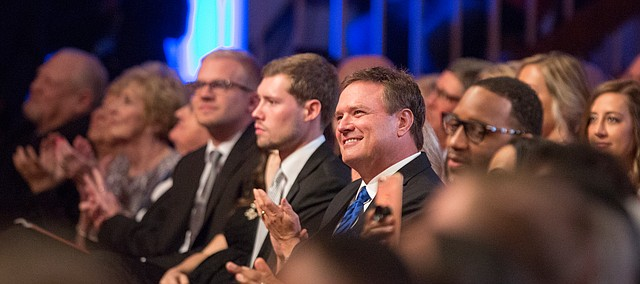 Kansas head coach Bill Self smiles shortly before his introduction during the Naismith Memorial Basketball Hall of Fame induction ceremony on Friday, Sept. 8 2017 at Symphony Hall in Springfield, Massachusetts.