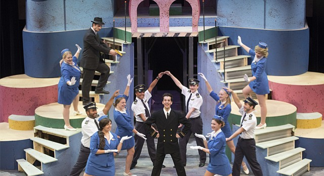 "Above: The cast of Theatre Lawrence's ""Catch Me If You Can"" gathers around Alex Castaneda, who plays prolific con artist Frank Abagnale Jr."
