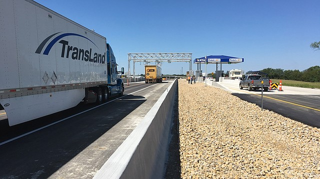 "This picture shows the toll plaza in the westbound lanes of the Kansas Turnpike's eastern terminal near Bonner Springs, after one lane of ""open road tolling"" was opened to traffic Aug. 24, 2017. Vehicles with K-Tags can drive through at 55 mph, a speed limit that will go up to 75 mph after construction is completed, expected before the end of the year."