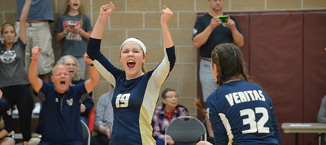 Veritas Christian School left outside hitter Jessie Swisher cheers after helping her team defeat Bishop Seabury Academy 2-1 on Sept. 12, 2017 at the East Lawrence Recreation Center