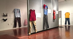 "Outfits hang on the walls for the ""What Were You Wearing? Survivor Art Installation"" on display in the Kansas Union gallery on the University of Kansas campus, pictured Monday, Sept. 11, 2017. The display, open through Friday, was enabled by the KU Sexual Assault Prevention and Education Center."