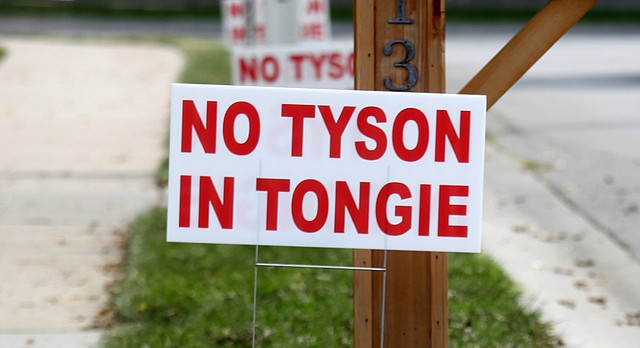 Yard signs such as these, pictured Tuesday, Sept. 12, 2017, are popping up across Tonganoxie in opposition to plans by Tyson Foods Inc. to build a $320 million chicken-processing plant south of the city.