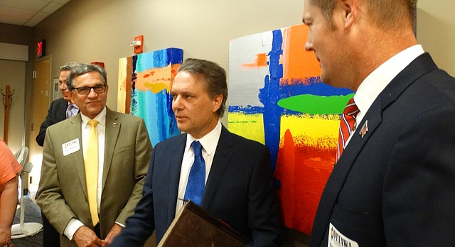 "Lt. Gov. Jeff Colyer, center, talks with Ottawa City Commissioner Mike Skidmore, left, and attorney Brandon Jones, right, following an Ottawa Area Chamber of Commerce ""Eggs and Issues"" breakfast Wednesday at Ransom Memorial Hospital."