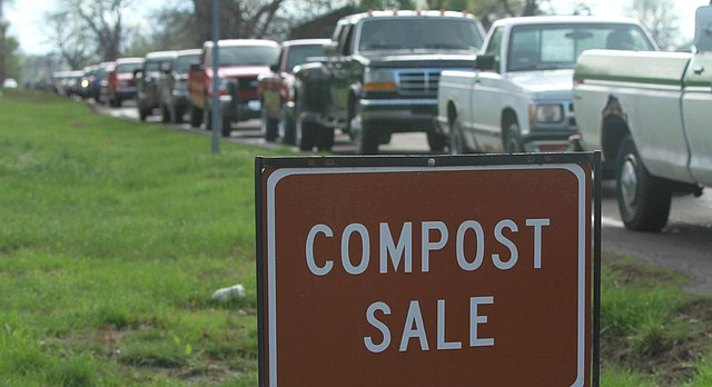 In this file photo from March 23, 2012, trucks line up for the city's compost sale at the city's compost facility, 1420 E. 11th St.