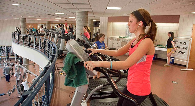 In this file photo from January 2013, University of Kansas student Morgan Cross works out at the Ambler Student Recreation Fitness Center on the KU campus.