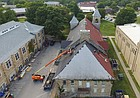 Workers replace the roof on Hiawatha Hall at Haskell Indian Nations University Thursday, Sept. 14, 2017.