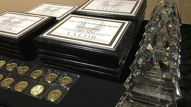 Several Valor First Responder Awards lie on a table at a recognition ceremony Friday, Sept. 15, 2017 at the Doubletree Inn, 200 McDonald Drive. Local organizers presented the awards to first responders recognized for acts taken during life-threatening situations.