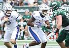 Kansas quarterback Carter Stanley (9) look to cut around the Ohio defense during the second quarter on Saturday, Sept. 16, 2017 at Peden Stadium in Athens, Ohio.