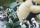 Kansas defensive tackle Daniel Wise (96) is stopped at the line as Ohio quarterback Nathan Rourke (12) throws to a receiver during the first quarter on Saturday, Sept. 16, 2017 at Peden Stadium in Athens, Ohio.