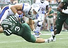 Kansas wide receiver Chase Harrell (3) is taken off of his feet as he is hit by Ohio cornerback Bradd Ellis (3) during the fourth quarter on Saturday, Sept. 16, 2017 at Peden Stadium in Athens, Ohio.