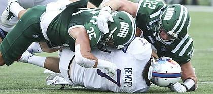 Kansas quarterback Peyton Bender (7) is driven to the turf by Ohio linebacker Dylan Conner (35) and Ohio linebacker Quentin Poling (32) during the third quarter on Saturday, Sept. 16, 2017 at Peden Stadium in Athens, Ohio.