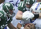 Kansas quarterback Peyton Bender (7) is sacked from behind by Ohio defensive end Trent Smart (90) during the second quarter on Saturday, Sept. 16, 2017 at Peden Stadium in Athens, Ohio.