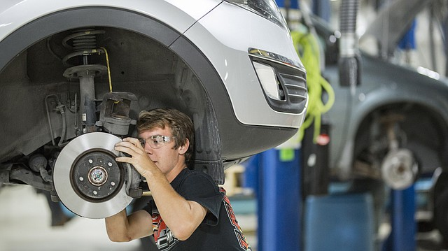 Free State senior Nick Howard works to change the brake pads on a vehicle in his Advanced Auto Tech class on Friday, Sept. 14, 2017 at the Peaslee Technical Training Center, 2920 Haskell Ave., on Friday, Sept. 14, 2017. Peaslee Tech, which opened an auto tech center this year,  is exploring a way to help solve its annual funding search.