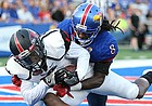 Southeast Missouri wide receiver Trevon Billington (14) pulls in a touchdown catch before Kansas cornerback Shakial Taylor (8) during the second quarter on Saturday, Sept. 2, 2017 at Memorial Stadium.