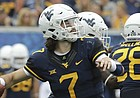 West Virginia quarterback Will Grier (7) attempts a pass during the second half of an NCAA college football game against Delaware State, Saturday, Sept. 16, 2017, in Morgantown, W.Va. (AP Photo/Raymond Thompson)
