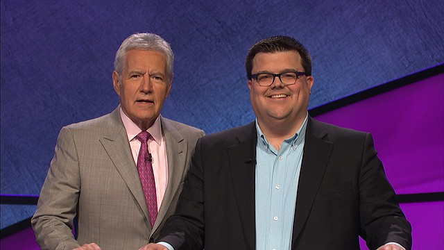 """Andy Hyland, a University of Kansas spokesman and former Journal-World reporter, poses with """"Jeopardy!"""" host Alex Trebek during a recent taping of the show. Hyland, who serves as assistant director of strategic communications at KU, resides in Mission. He took home second place and $2,000 on his episode, which aired Monday afternoon."""