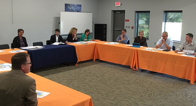 Members of the Douglas County Commission, Lawrence City Commission and Lawrence school board meet Sept. 18, 2017, at the Baker Wetlands Discovery Center.