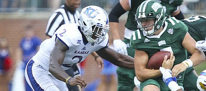 Kansas defensive end Dorance Armstrong Jr. (2) and Kansas defensive tackle Kellen Ash (97) bring down Ohio quarterback Quinton Maxwell (7) during the second quarter on Saturday, Sept. 16, 2017 at Peden Stadium in Athens, Ohio.
