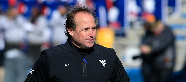 West Virginia football coach Dana Holgorsen walks the sidelines during the first half of his team's last trip to Memorial Stadium on Saturday, Nov. 21, 2015. The Mountaineers defeated the Jayhawks 49-0 that day to move to 1-1 all-time in Lawrence.