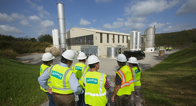 Tour attendees gather outside the new methane plant at the Hamm landfill north of Lawrence on Wednesday, Sept. 20, 2017. The plant takes methane emitted by decomposing trash and refines it into fuel.