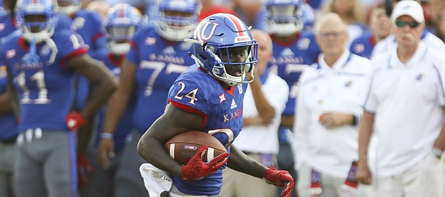 Kansas running back Taylor Martin (24) looks for room during the first quarter on Saturday, Sept. 2, 2017 at Memorial Stadium.