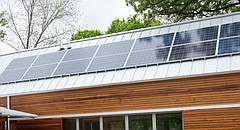 This file photo from May 2, 2016 shows a bank of solar panels atop a house project by the University of Kansas' Studio 804 architecture class, at 1200 Pennsylvania St.