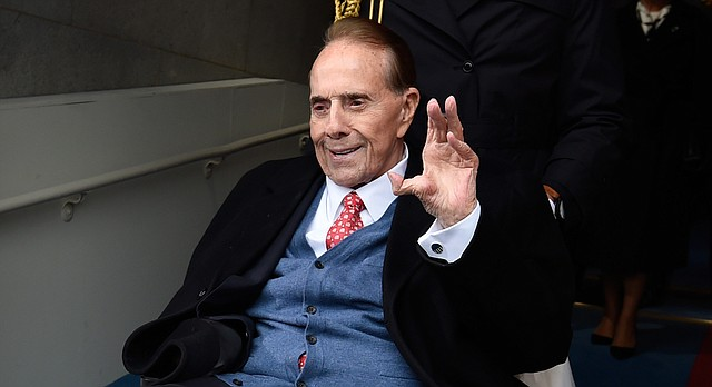Former Senate Majority Leader Bob Dole arrives for the Presidential Inauguration of Donald Trump on Capitol Hill in Washington, Friday, Jan. 20, 2017. (Saul Loeb via AP, Pool)