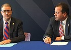 """New Kansas chancellor, Doug Girod, left, and KU athletic director Sheahon Zenger, discuss with reporters plans for the athletic department's """"Raise The Chant"""" fund-raising strategy, a facility-focused endeavor which focuses primarily on football and aims to raise $350 million over the course of five years."""