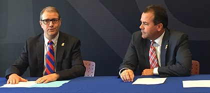 "New Kansas chancellor, Doug Girod, left, and KU athletic director Sheahon Zenger, discuss with reporters plans for the athletic department's ""Raise The Chant"" fund-raising strategy, a facility-focused endeavor which focuses primarily on football and aims to raise $350 million over the course of five years."