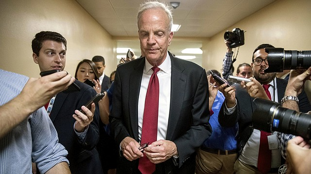 In this July 18, 2017, file photo, U.S. Sen. Jerry Moran, R-Kan., is pursued by reporters as he arrives on Capitol Hill in Washington. Moran has made national headlines for stalling health care overhaul legislation. (AP Photo/Andrew Harnik, File)