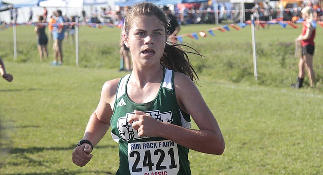 Free State junior Julia Larkin approaches the finish line in the varsity girls gold division race of the Rim Rock Classic on Saturday at Rim Rock Farm. Larkin led the Firebirds with a 5,000-meter time of 20:41.