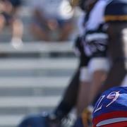 Kansas linebacker Joe Dineen Jr. (29) laments a West Virginia touchdown during the second quarter on Saturday, Sept. 23, 2017 at Memorial Stadium.