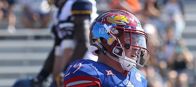 Kansas linebacker Joe Dineen Jr. (29) laments a West Virginia touchdown during the second quarter on Saturday, Sept. 23, 2017 at Memorial Stadium.