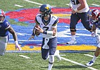 West Virginia quarterback Will Grier (7) scrambles for a long run between Kansas defensive end Dorance Armstrong Jr. (2) and Kansas linebacker Keith Loneker Jr. (47) during the fourth quarter on Saturday, Sept. 23, 2017 at Memorial Stadium.