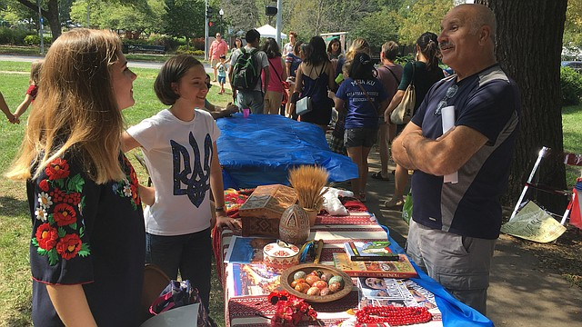 Olha Korinets, left, and Oksana Husieva, right, talk to festival-goers about Ukrainian culture Sunday, Sept. 24, 2017 at the Festival of Cultures at South Park. Items on display included pysanka, handcrafted Easter eggs with traditional Ukrainian designs etched in wax.