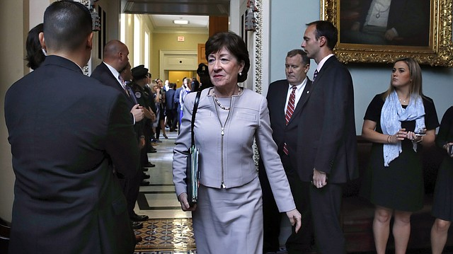 In this photo from Sept. 19, 2017, Sen. Susan Collins, R-Maine, center, leaves a meeting with Senate Republicans on Capitol Hill in Washington. (AP Photo/Jacquelyn Martin)